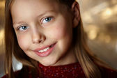 Closeup portrait of attractive smiling little girl — Stock Photo