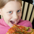 Stock Photo: Cheerful little girl with pizza