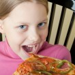 Cheerful little girl with pizza — Stock Photo