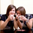 Two girls with cups of tea — Stock Photo