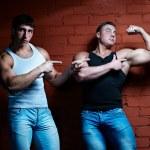 Постер, плакат: Two muscular guys