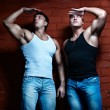 Two muscular guys watching — Stock Photo