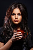 Portrait of beautiful young woman with cup — Stock Photo
