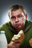 Portrait of funny corpulent man with bottle and bread — Stock Photo