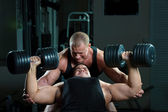 Two bodybuilders training in gym — Stock Photo