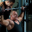 Stock Photo: Two bodybuilders training in gym