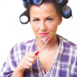 Displease housewife with tooth brush — Stock Photo