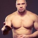 Contrasty portrait of a sportsman — Stock Photo