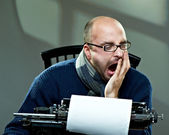 Serious bald man in scarf and glasses yawning — Stock Photo