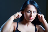 I Can't Hear You. Young woman covering her ears — Stock Photo