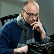 Photo: Portrait of a bald writer