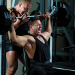 Bodybuilders training in gym — Stock Photo