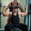 Bodybuilders training in gym — Stock Photo #4665983