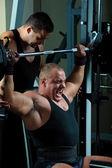 Bodybuilders training in gym — Stock Photo