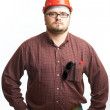 Royalty-Free Stock Photo: Serious builder in glasses and red hard hat