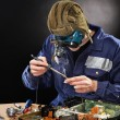 Crazy genious witth soldering iron — Stock Photo #5048158