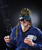 Crazy genious witth soldering iron — Stock Photo