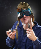 Crazy genious witth soldering iron — Stock Photo