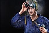 Crazy genius guy wearing weird hat — Stock Photo