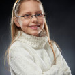 Portrait of a cheerful little girl in eyeglasses — Stock Photo #5248284