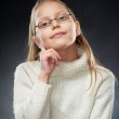 Portrait of a cheerful little girl in eyeglasses — Stock Photo #5248291