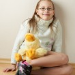 Portrait of a little girl in eyeglasses with a toy — Stock Photo #5248305