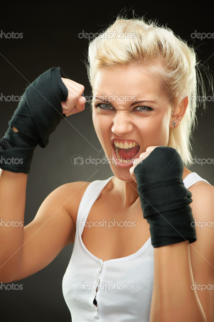 Agressive young beautiful blond boxer girl with bandages on hands, studio shot — Stock Photo #5248177