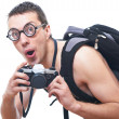 Stock Photo: Portrait of a young nerd with old fashioned camera