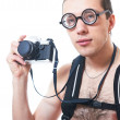 Portrait of a young nerd with old fashioned camera - Stock Photo