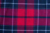 Texture of red-black checkered fabric — Stock Photo