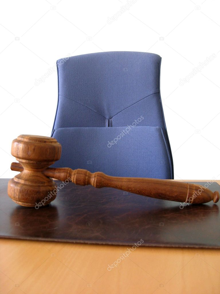 Old wooden gavel ,blue chair and court desk — Stock Photo #4585339