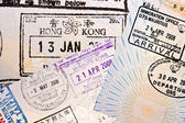 Immigration arrival stamps on passport — Stock Photo