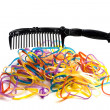 Colorful rubber bands and comb — Stock Photo