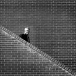 Stock Photo: Men Walking down Stairs Brick Wall