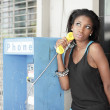 Stock Photo: Womon pay-phone