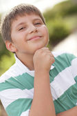 Boy with hand under chin — Stock Photo
