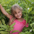 Stock Photo: Girl in bushes