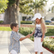 Young boy proposing - Stockfoto