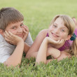 Stock Photo: Kids laying on the grass