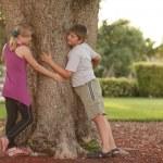 Kids hugging the tree — Stock Photo