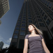 Woman by office buildings — Stock Photo
