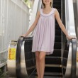 Woman by the escalator — Stock Photo