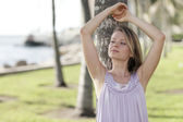 Woman with arms above her head — Stock Photo