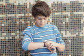 Boy checking the time — Stock Photo