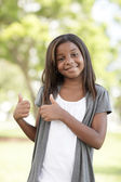 Child showing two thumbs-up — Stock Photo