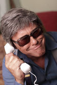 Funky businessman on the phone — Stockfoto
