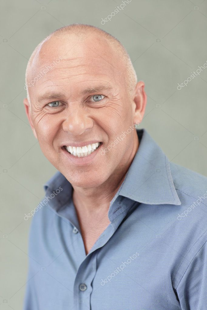 Headshot of a handsome businessman smiling  Stock Photo #4447292