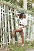 Woman posing by the fence — Stock Photo