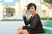 Attractive woman waving — Stock Photo