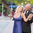 Attractive couple dancing — Stock Photo